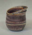 odd shaped cup with manganese glaze cone 10